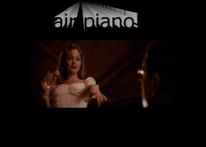 Angelina Jolie plays the Air Piano