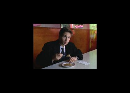 Mulder Competes in a Pie-Eating Contest