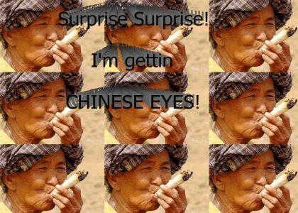 Old asian lady smokin a giant J