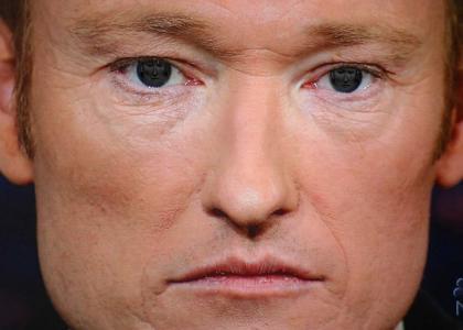 Conan stares into a mirror