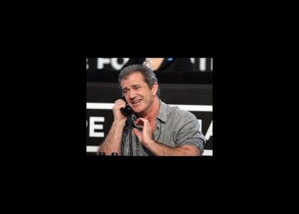 Mel Gibson talks on the phone