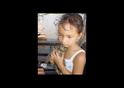 Little Girl holds Dead Kitten