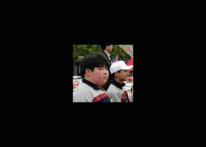 Fat Asian Kid doesn't change facial expressions