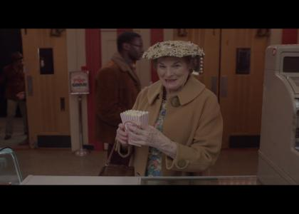 Old lady gets popcorn