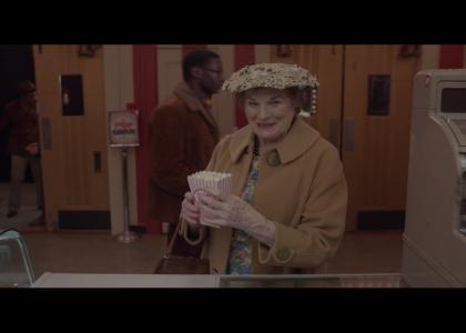 Old lady gets popcorn