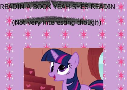 Twilight Sparkle is reading a book.