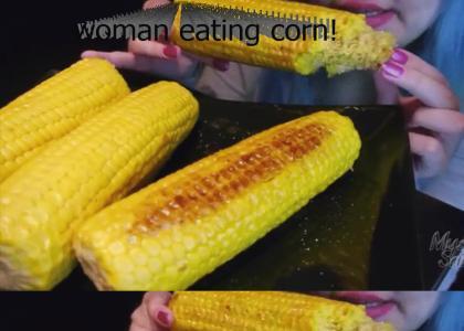 woman eats corn