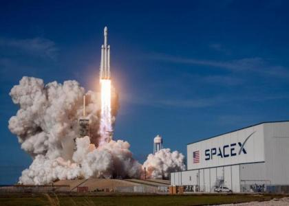 SpaceX launches new rocket primed for future crewed missions