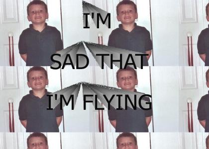 this kid is sad to be flying